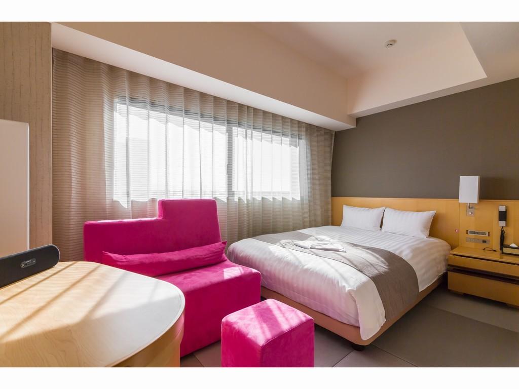 リラックスダブル 畳敷きにベッドの客室