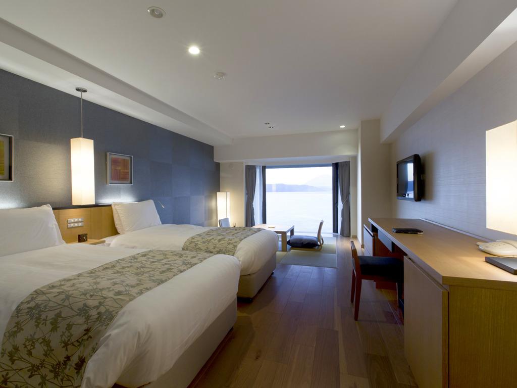 【スパリゾート館スタンダード和洋室】ベット2台と琉球畳8畳のお部屋です。