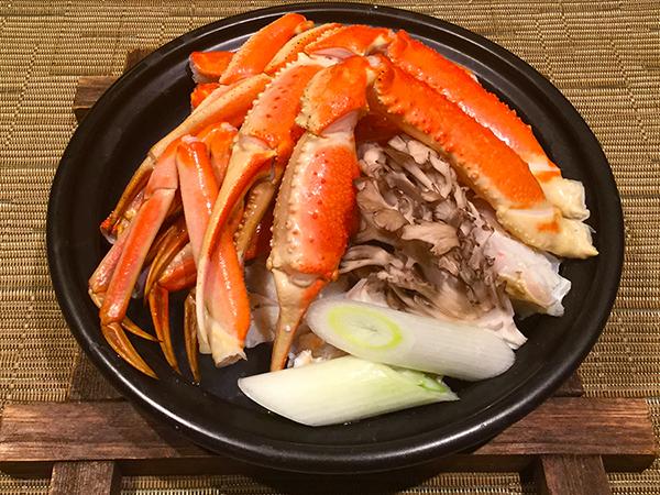 スタンダードYUBISOコースの魚料理をグレードアップ♪紅ズワイガニをあつあつタジン鍋で——