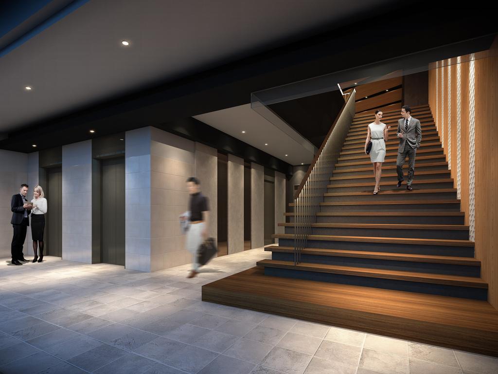 入口を抜けると、2階フロントへ繋がる開放的かつ落ち着いた雰囲気の階段が現れます