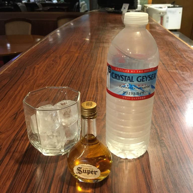 Mini-whisky bottle and mineral water